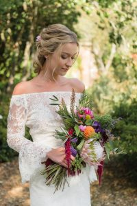 Bride in Court Lodge gardens by Kent wedding photographer Oakhouse Photography