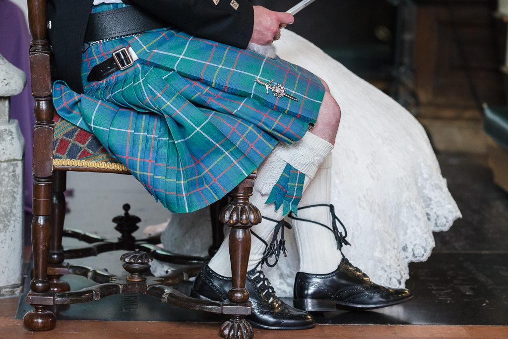 Detail photograph of groom's Scottish kilt at St Paulinus Church | Oakhouse Photography