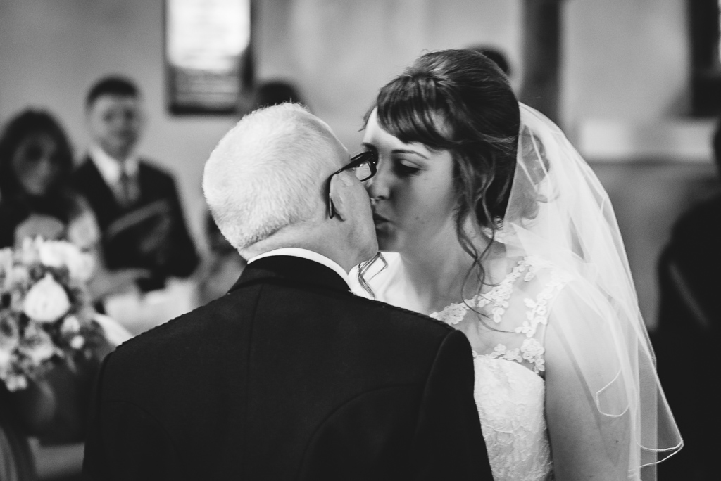 First kiss of bride and groom at St Paulinus Church wedding | Kent Wedding Photographers | Oakhouse Photography