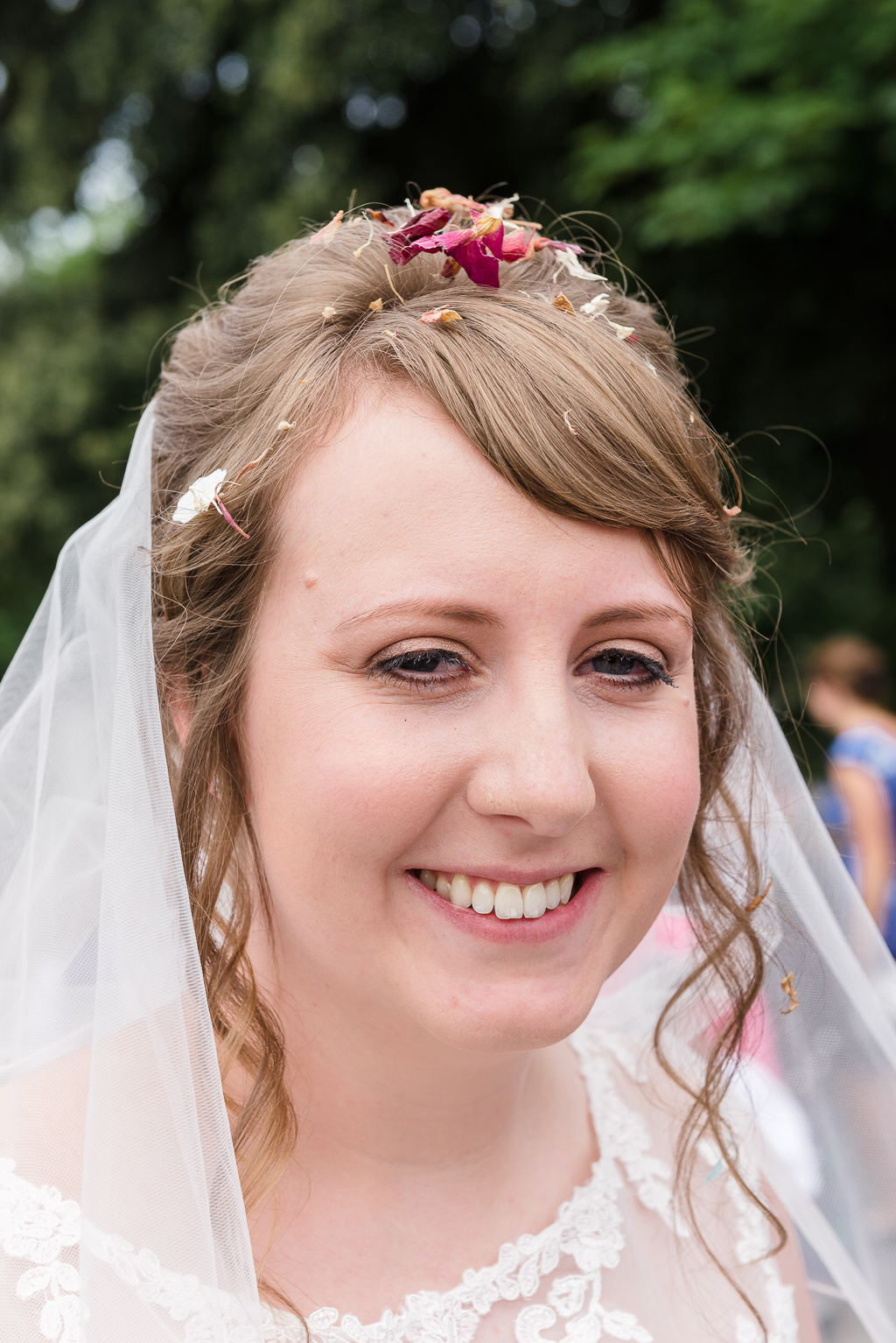 Bride portrait with confetti in her hair | Kent Wedding Photographer | Oakhouse Photography
