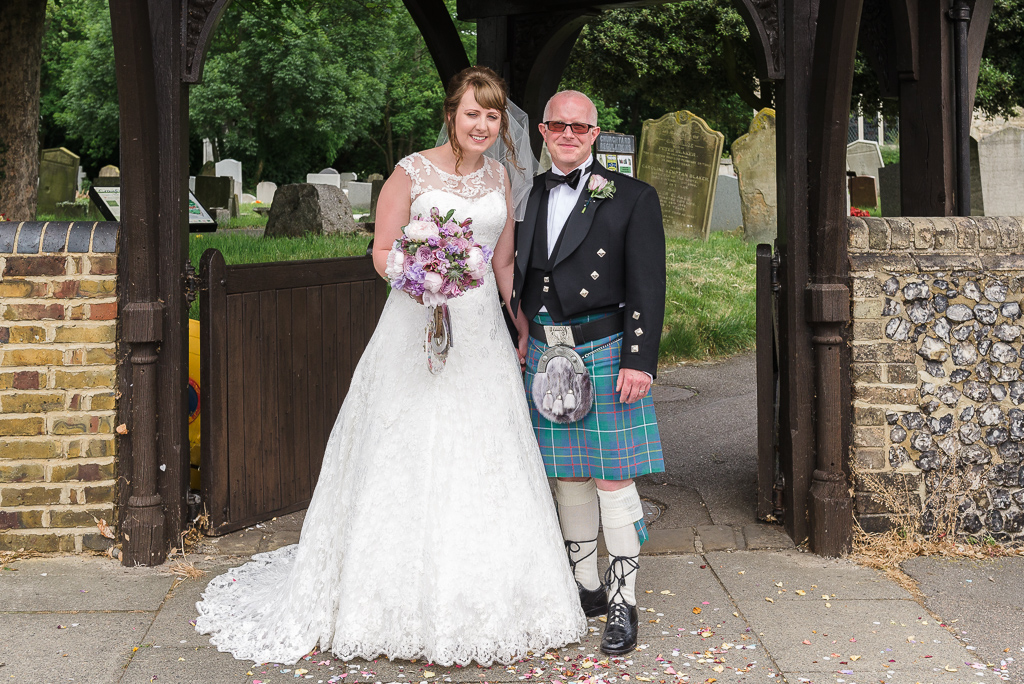 Bride and groom portrait outside St Paulinus Church Crayford | Oakhouse Photography