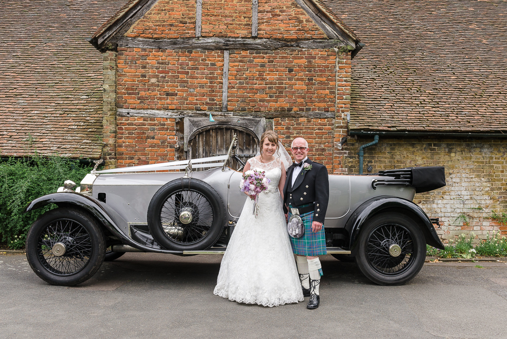 Bride and groom with Rolls Royce Silver Ghost wedding car at Hall Place Bexley | Oakhouse Photography