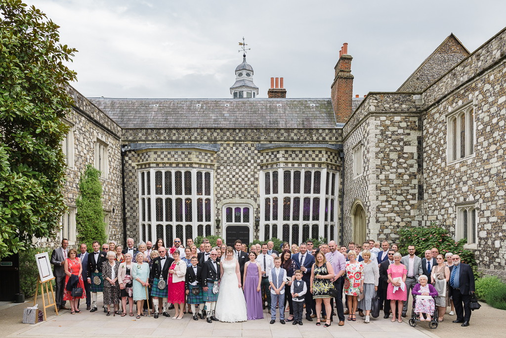 Large wedding group shot in the rear courtyard of Hall Place Bexley Kent | Oakhouse Photography