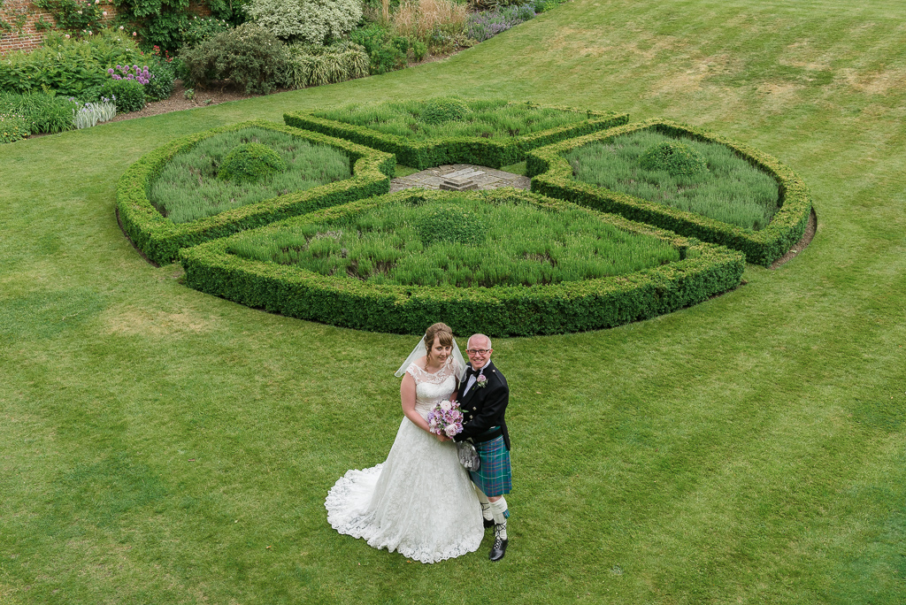 Overhead bride and groom portrait in rear gardens at Hall Place Bexley | Oakhouse Photography