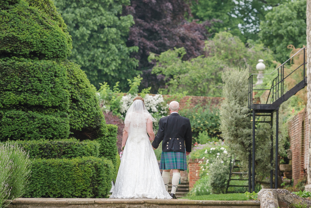 Informal shot of bride and groom walking in Hall Place gardens Bexley | Oakhouse Photography