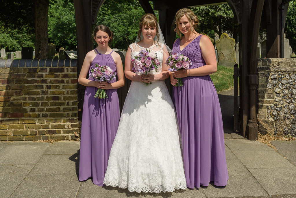 Bride and bridemaids pre-wedding photographs outside St Paulinus Church | Oakhouse Photography