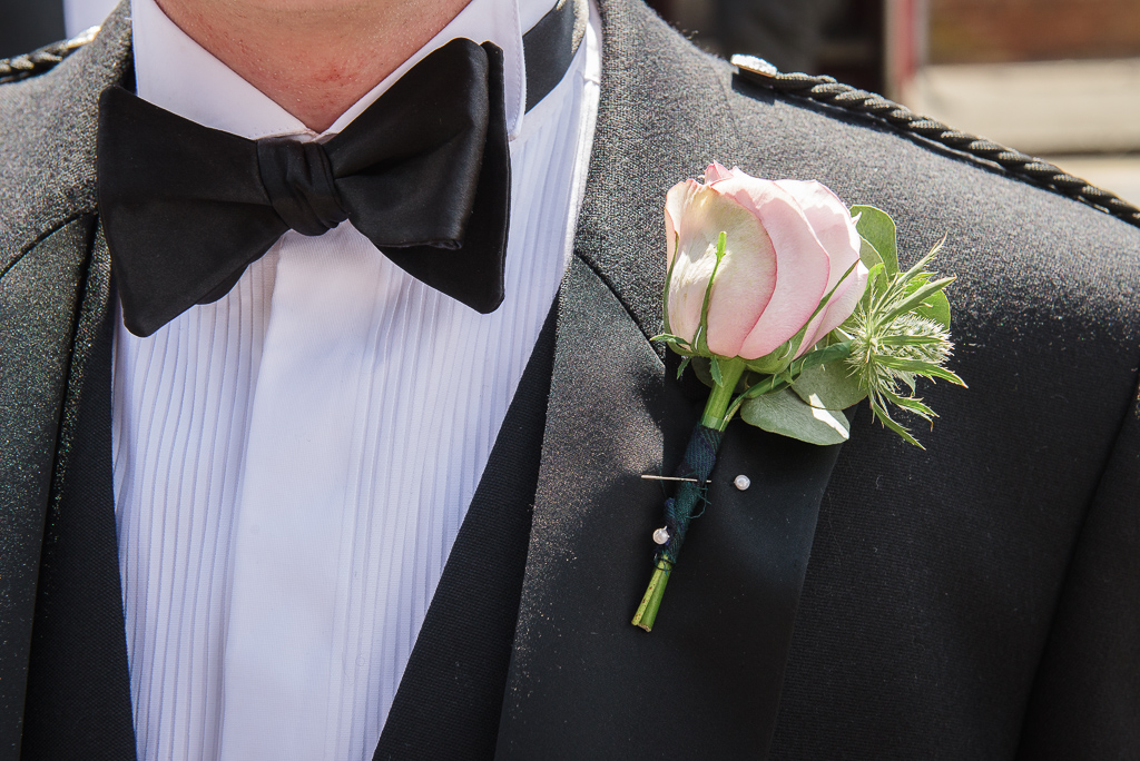 Groom's rose buttonhole at Crayford wedding | Kent Wedding Photographer | Oakhouse Photography