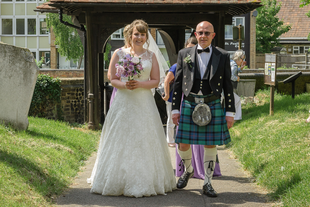 Bride and father proceeding into St Paulinus Church for the ceremony | Oakhouse Photography