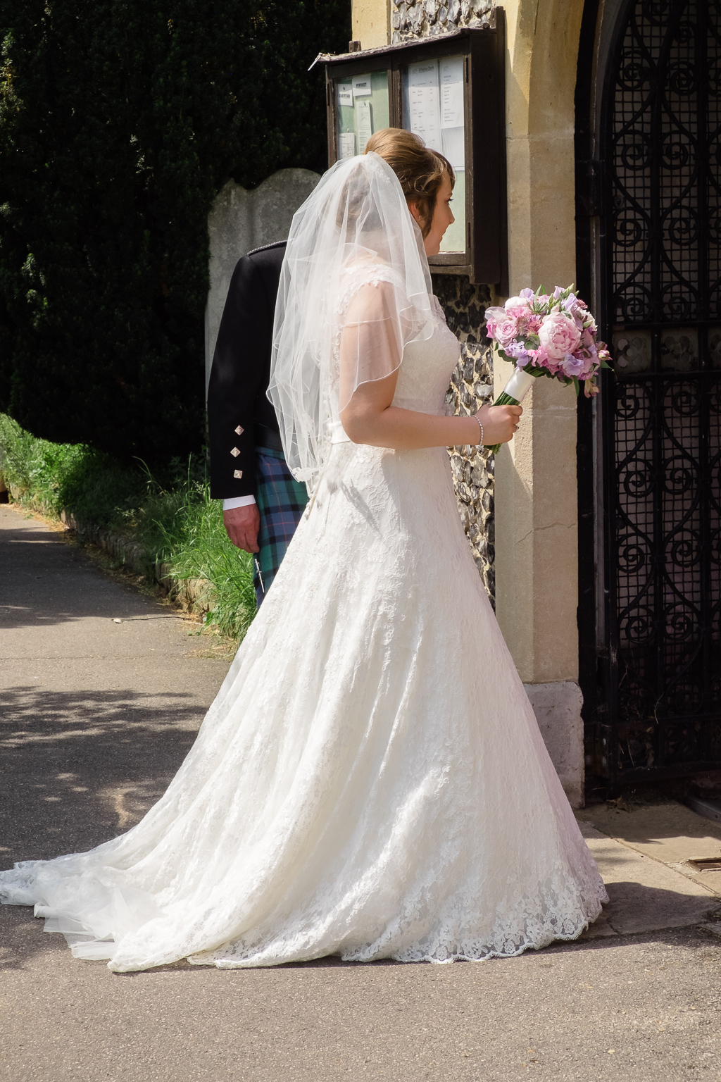 Bride entering St Paulinus Church for the wedding ceremony | Oakhouse Photography