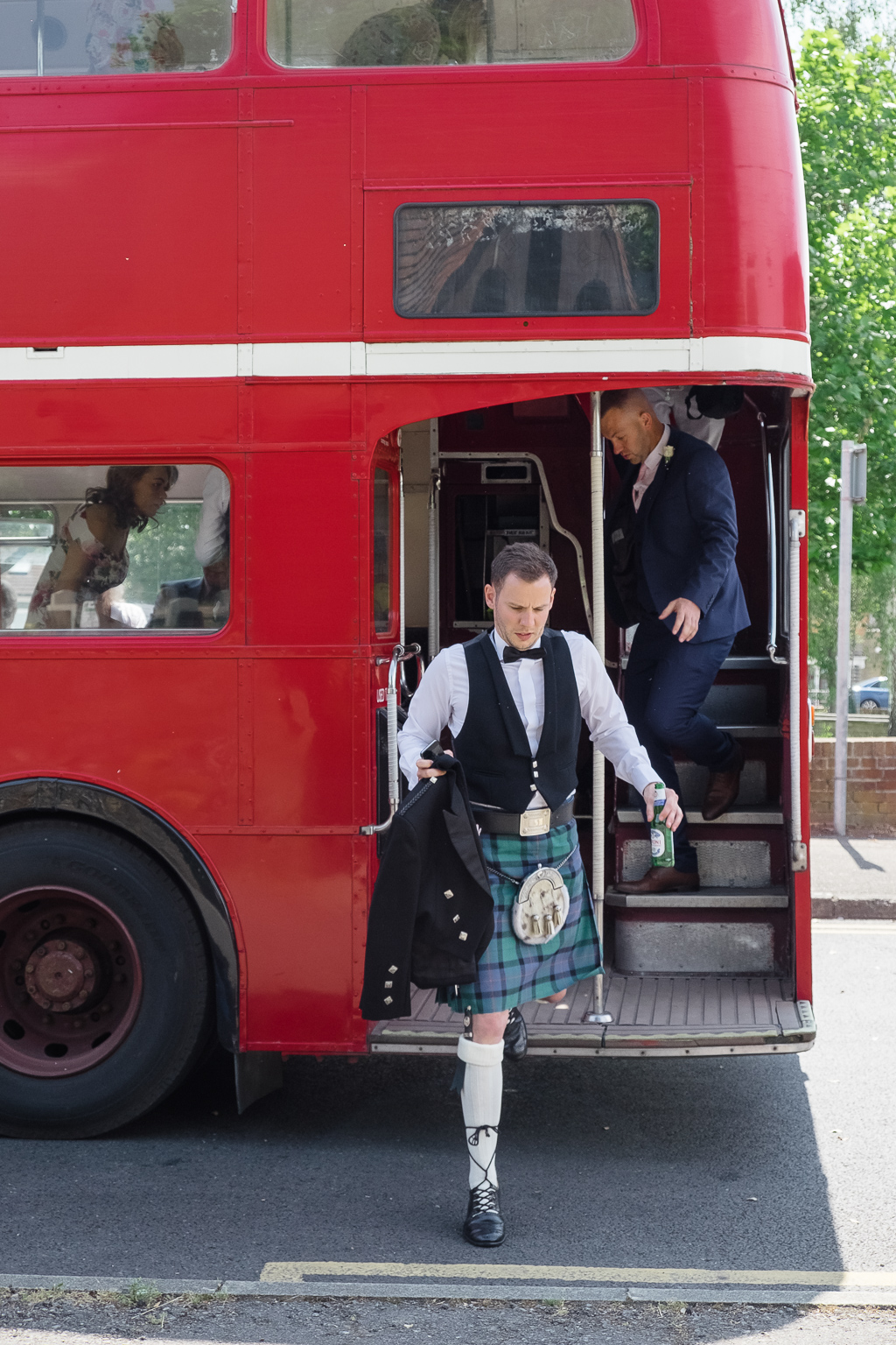 Guests Arriving On London Bus For Crayford Wedding | Crayford Wedding Photographers | Oakhouse Photography