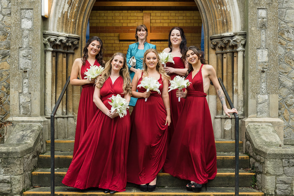 Bridesmaids and bride's mum pose outside Emmanuel Church before the wedding ceremony | Sidcup Wedding of Becky & Hugo | Oakhouse Photography