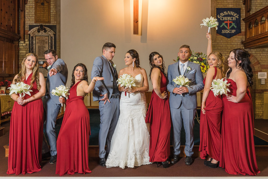 Fun group shot of the bride, groom, bridesmaids and ushers | Sidcup Wedding of Becky & Hugo | Oakhouse Photography