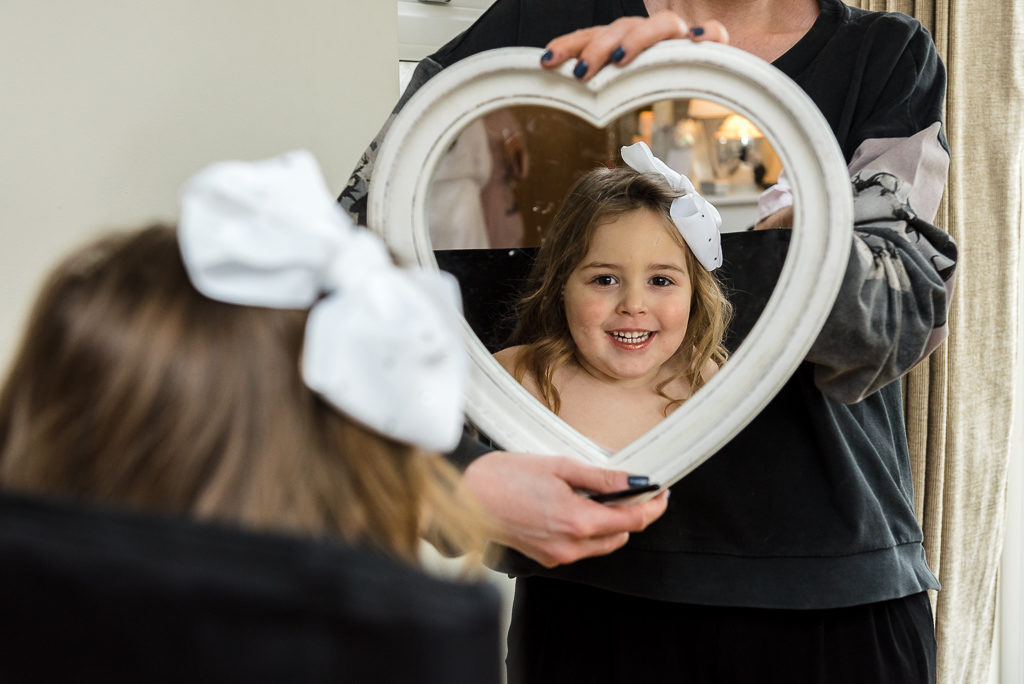 Flowergirl getting ready during bridal prep | Sidcup Wedding of Becky & Hugo | Oakhouse Photography