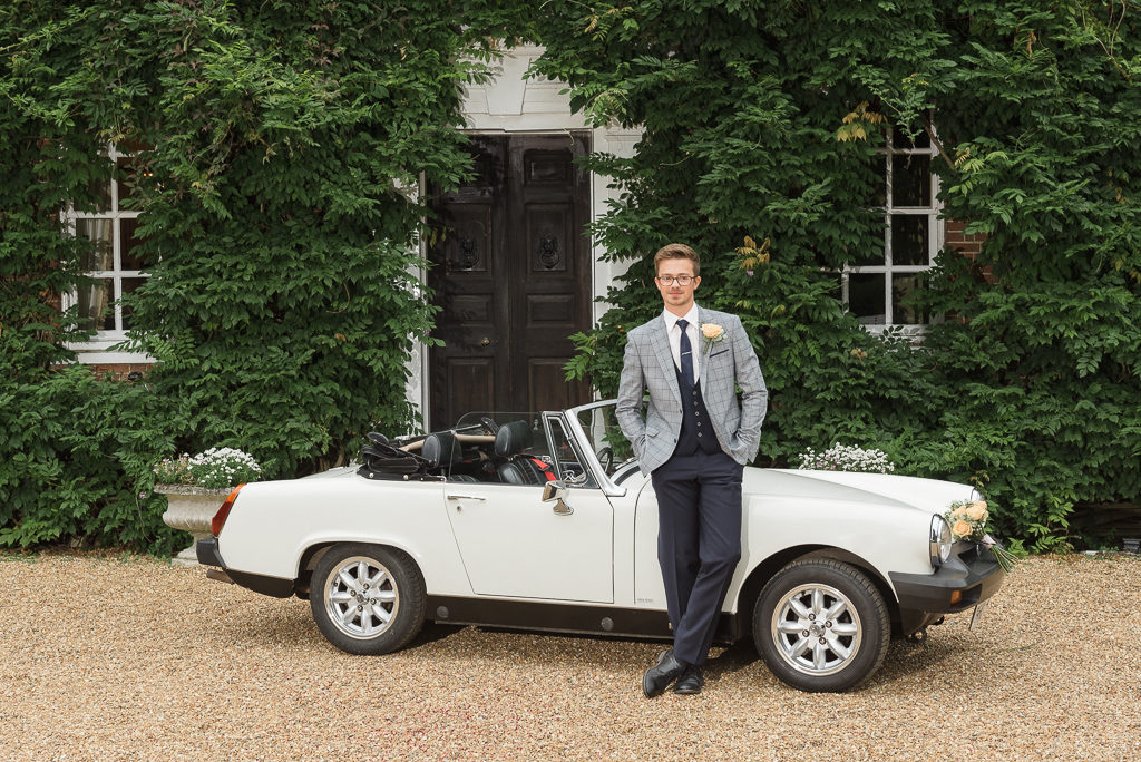 Groom with Millie the MG Sports Car photographed at Sprivers Mansion Elopement Photo Shoot | Kent Wedding Photographer | Oakhouse Photography