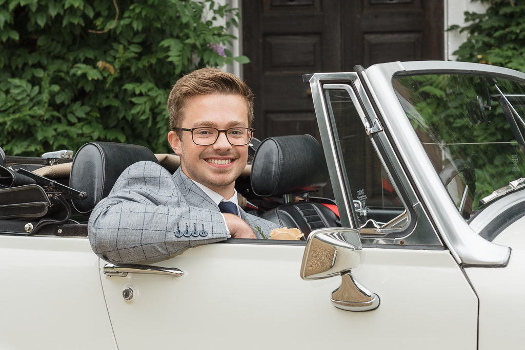 Groom in MG sportscar outside Sprivers Mansion Elopement Photo Shoot | Kent Wedding Photographer | Oakhouse Photography