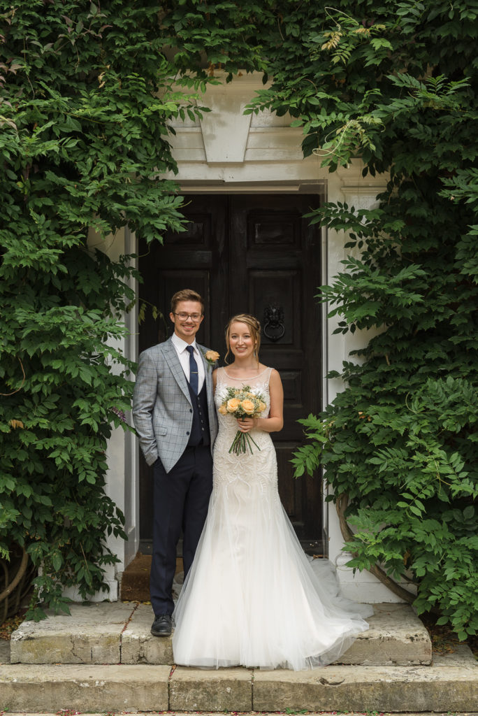 Bride and Groom posing outside Sprivers Mansion Elopement Photo Shoot   Kent Wedding Photographer   Oakhouse Photography
