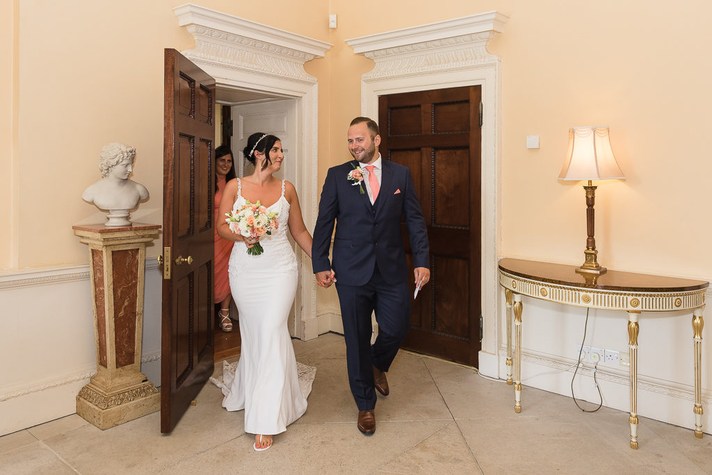 Bride and groom leaving the ceremony at Danson House Bexley wedding | Oakhouse Photography
