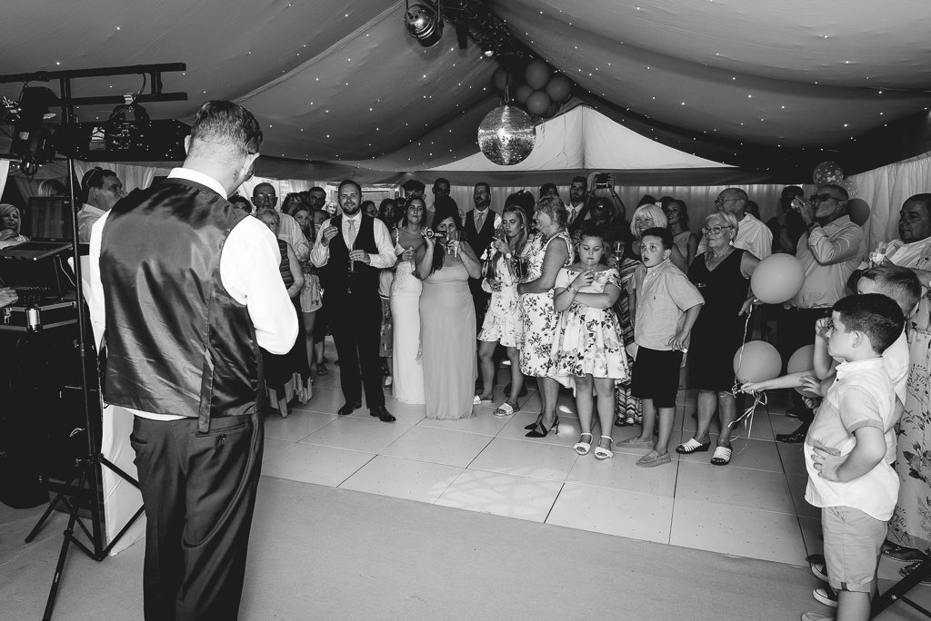 Wedding reception celebrations and speeches in the bride and groom's marquee | Oakhouse Photography