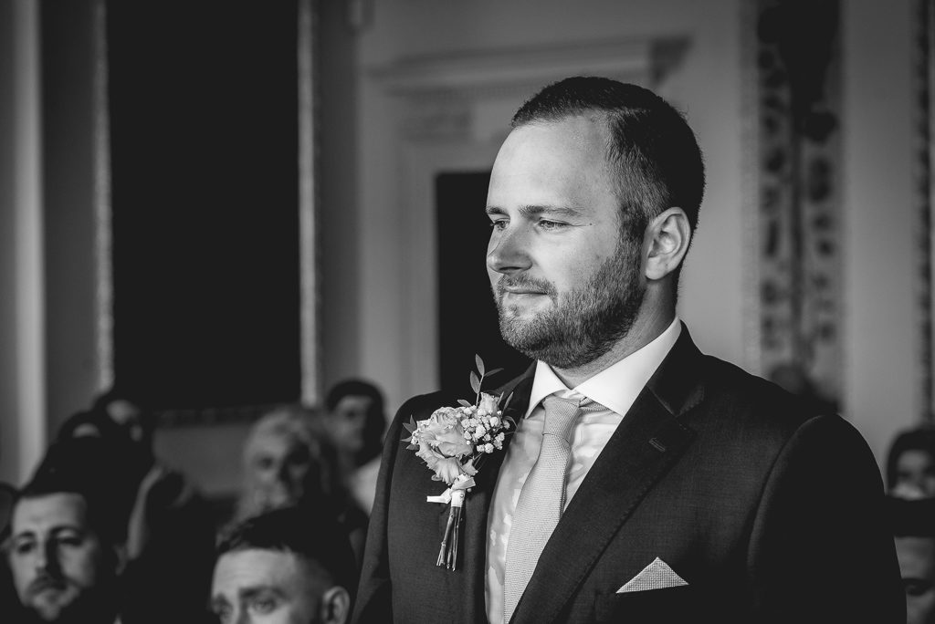 Groom during the wedding ceremony  at Danson House Bexley wedding | Oakhouse Photography