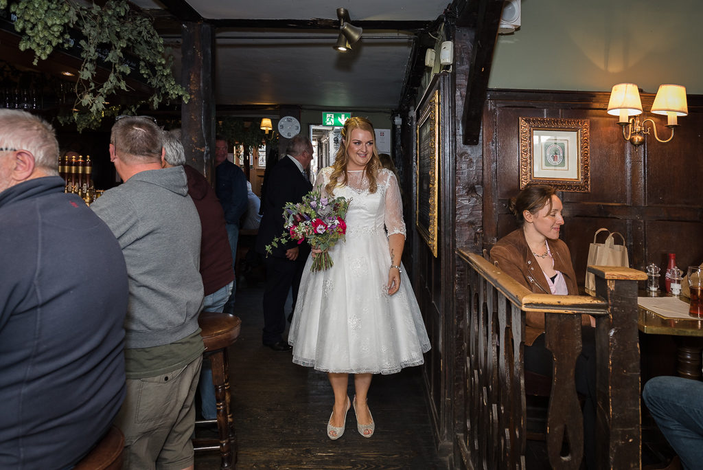 Bride leaving for wedding ceremony from The Sun Inn Faversham Kent | Oakhouse Photography