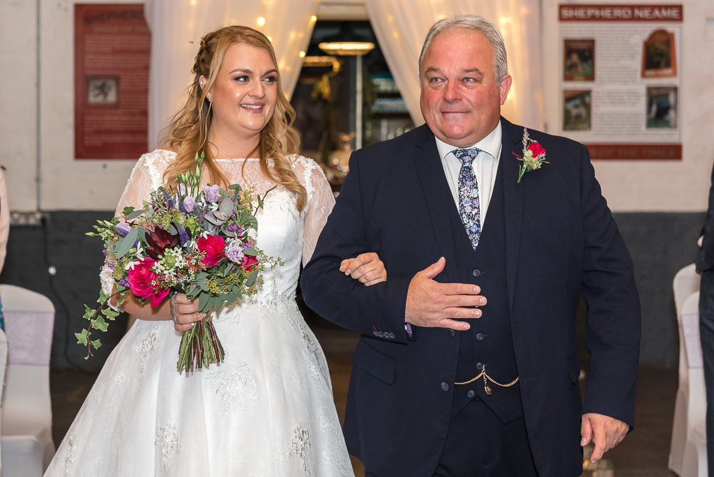 Bride and father entering the wedding ceremony at The Old Brewery Store Faversham | Oakhouse Photography