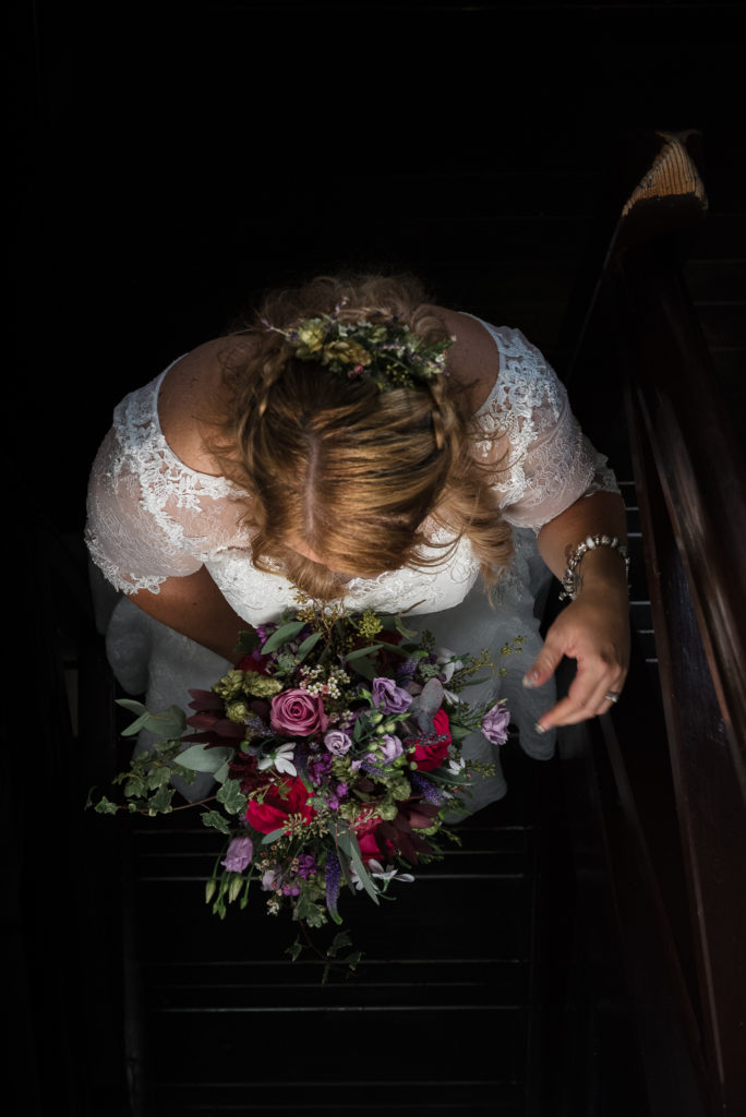 Creative wedding photograph of bride descending stairs at Shepherd Neame Brewery Faversham Kent | Oakhouse Photography